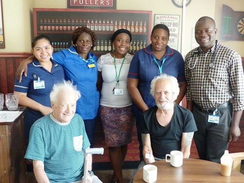 Patients Dennis Tilbury left and Norman Nye with Dr James Alegbeleye far right and Osler ward staff
