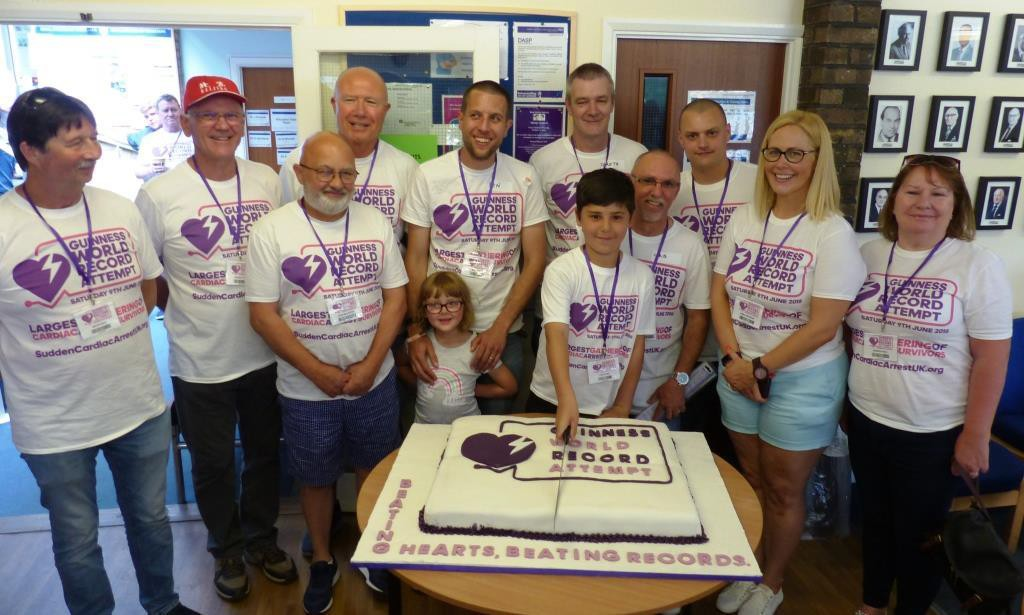Some of the survivors help Dan Fagg 11 cut the cake